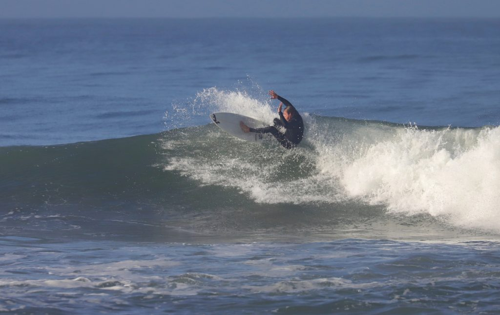 Focus On Health Patient Surfing in Huntington Beach after Successful Treatment